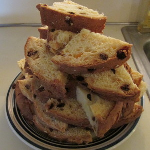 Panettone quartered slices ready to be batter dipped.